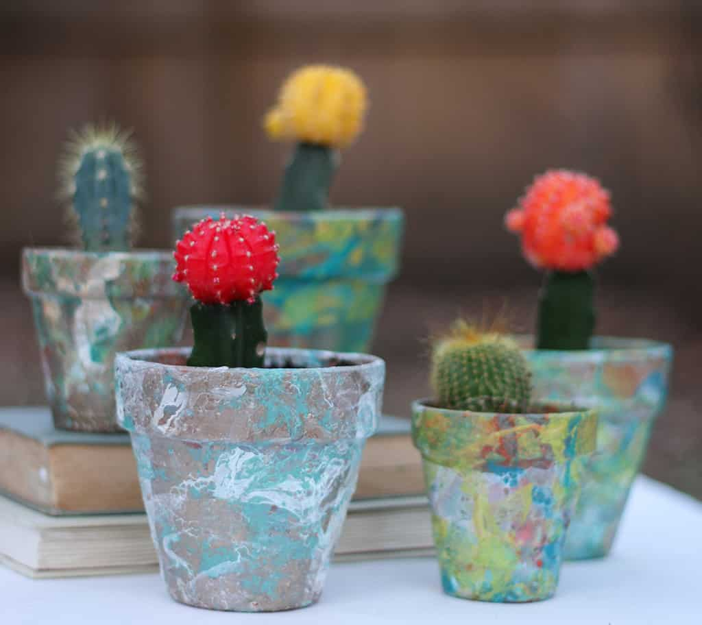 DIY tutorial on marble flower pots with nail polish