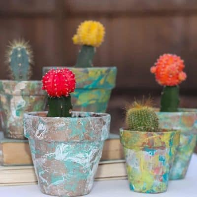 A DIY tutorial on marbling flower pots with nail polish. A cute and inexpensive project.