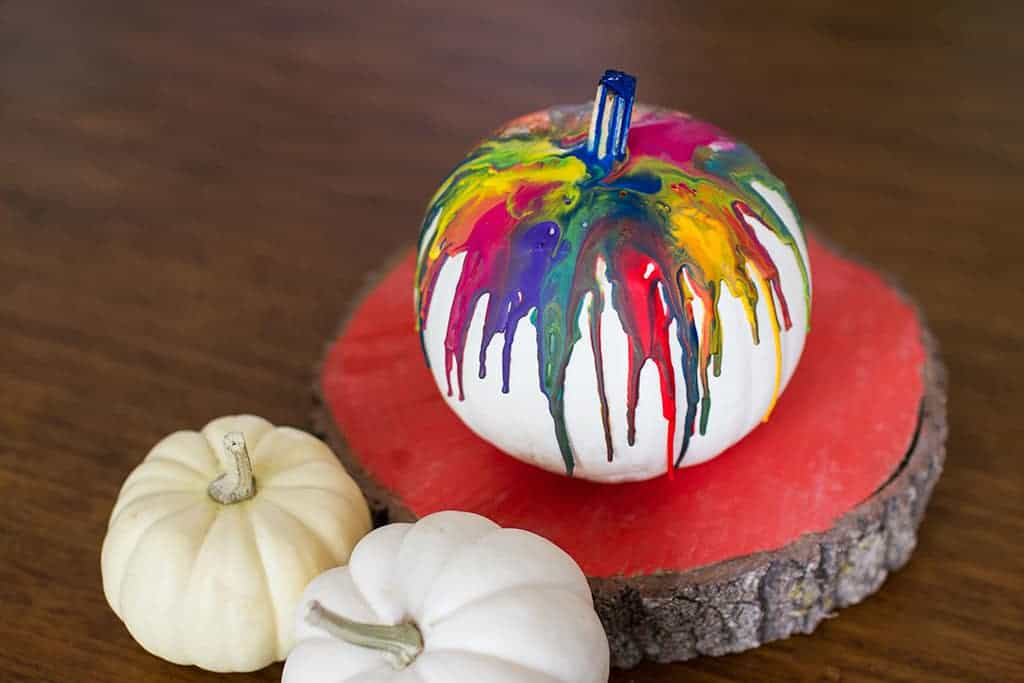 Audrey of Oh So Lovely Blog shares a fun and colorful DIY crayon drip pumpkin tutorial.