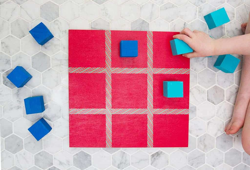 Audrey of Oh So Lovely Blog shares a DIY tic tac toe board tutorial that is super easy and fun to make—perfect for gift giving!