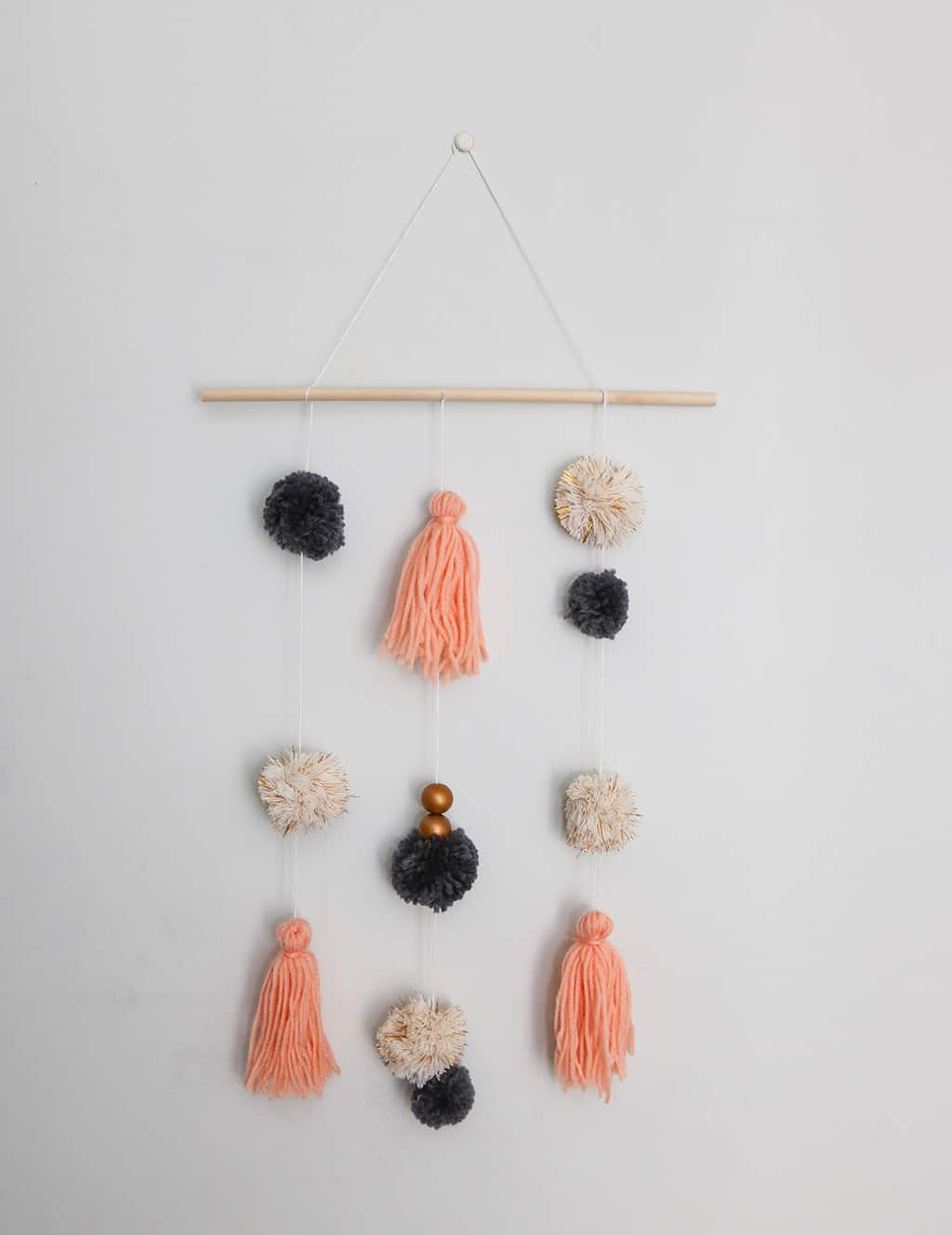 Colorful Fun And Easy Diy Pom Pom Wall Hanging Tutorial