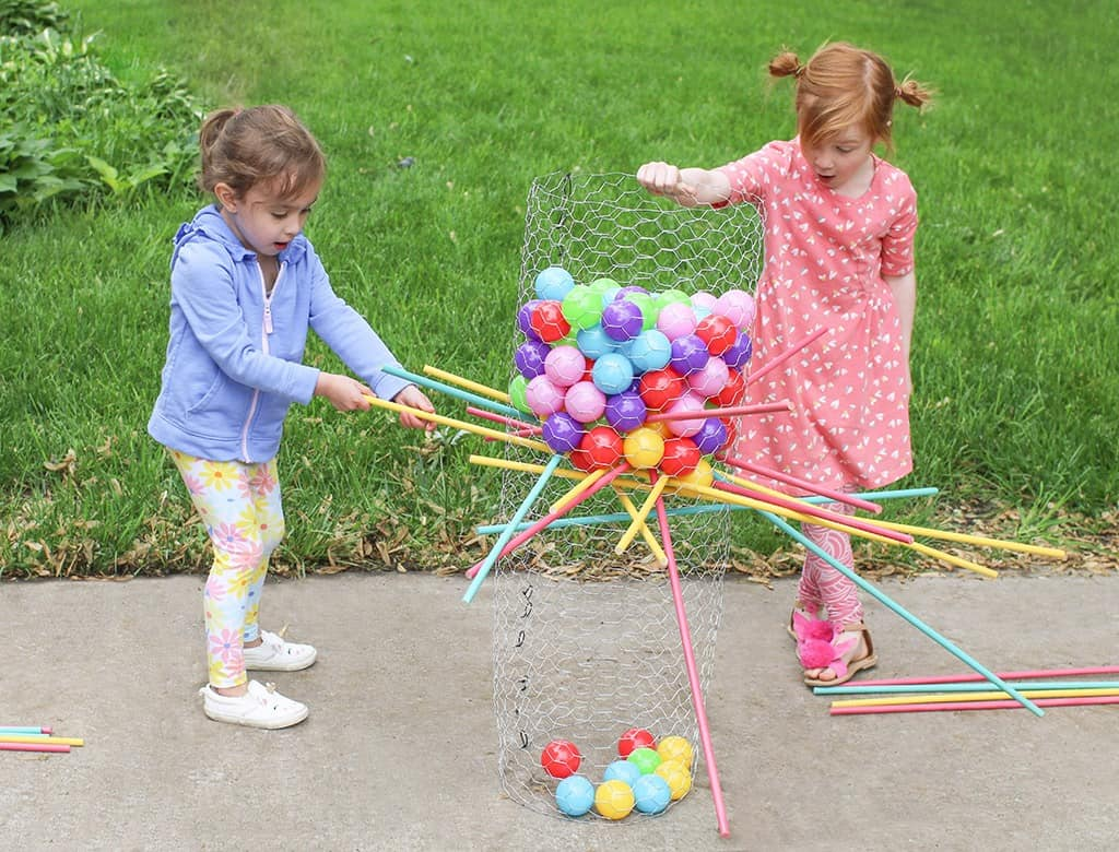 Audrey Kuether of Oh So Lovely shares a life size DIY Kerplunk yard game tutorial—perfect for outdoor entertaining!