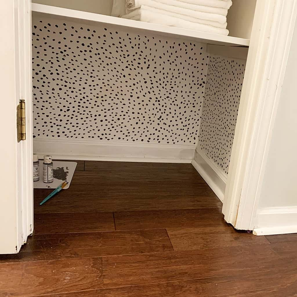 hand painted dot wallpaper in closet