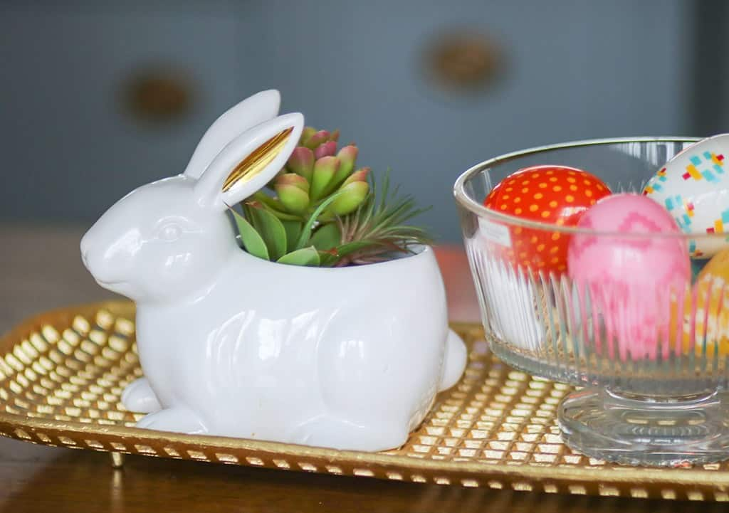 spring home tour colorful easter eggs in a crystal bowl next to a cute glass bunny