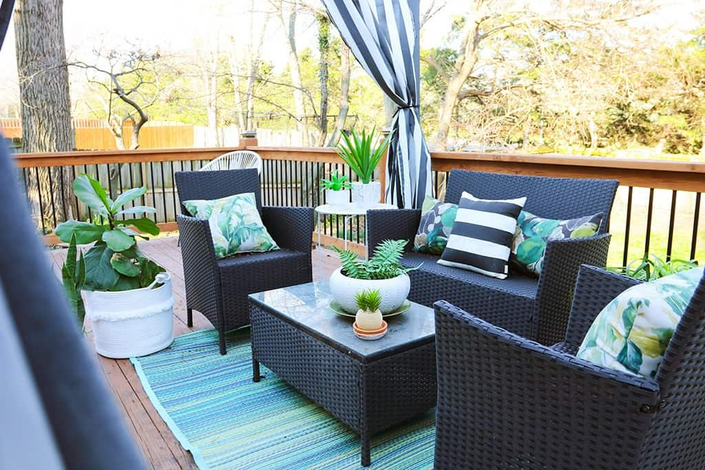 spring home tour deck pergola with palm and striped pillows