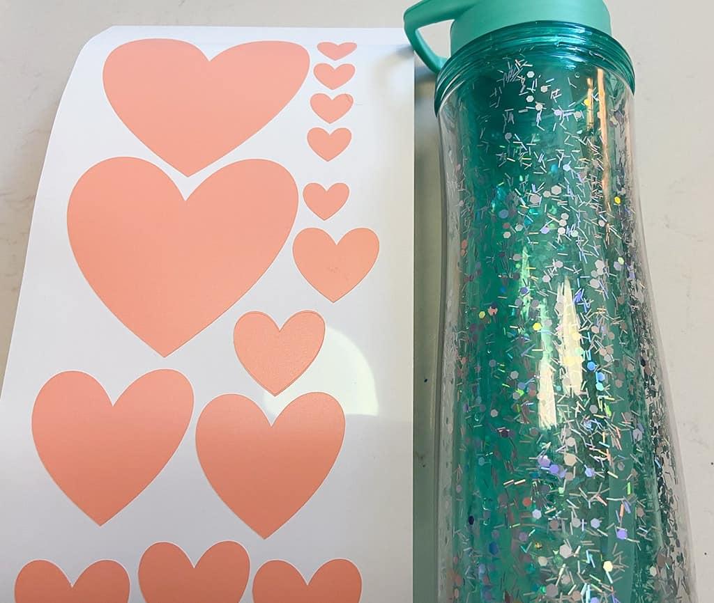 Heart vinyl cricut coral hearts on water bottle