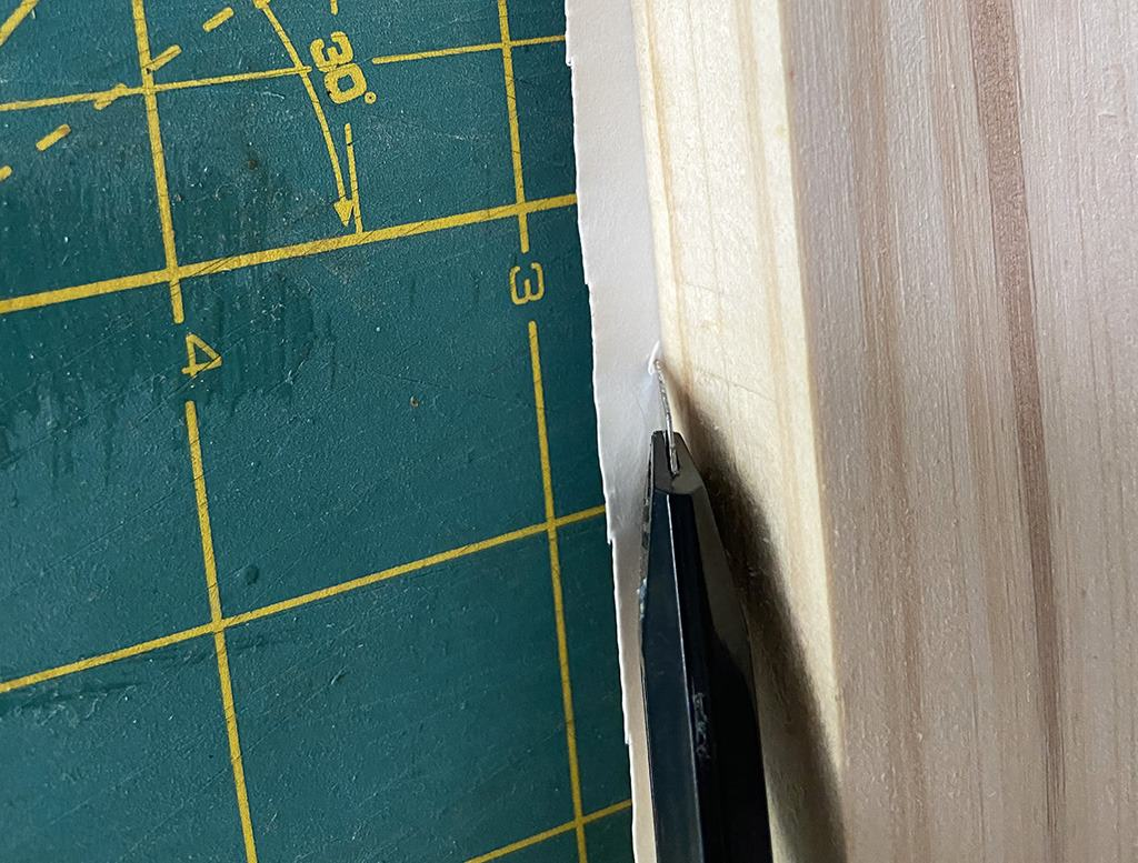 trim excess wallpaper