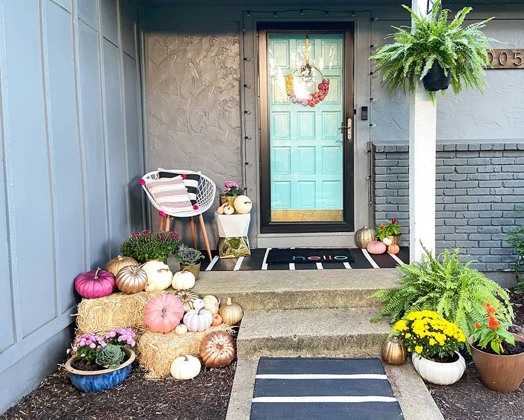 fall front porch with decor pumpkins and plants - outdoor fall decor
