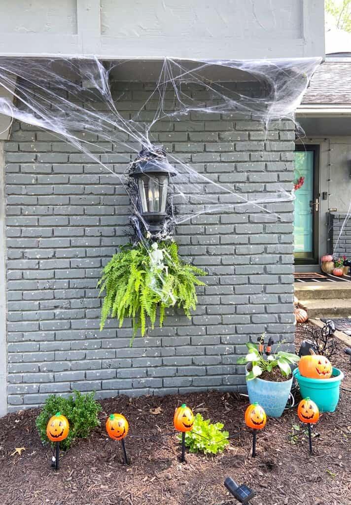 outdoor halloween decorations - spiderwebs, light up pumpkins