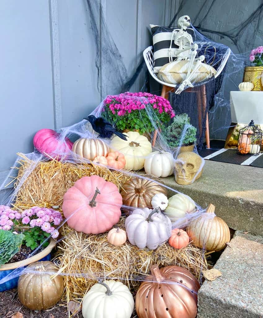 Faux pumpkins and spider webs! A fun & unique outdoor Halloween decor tour – at both day and nighttime!