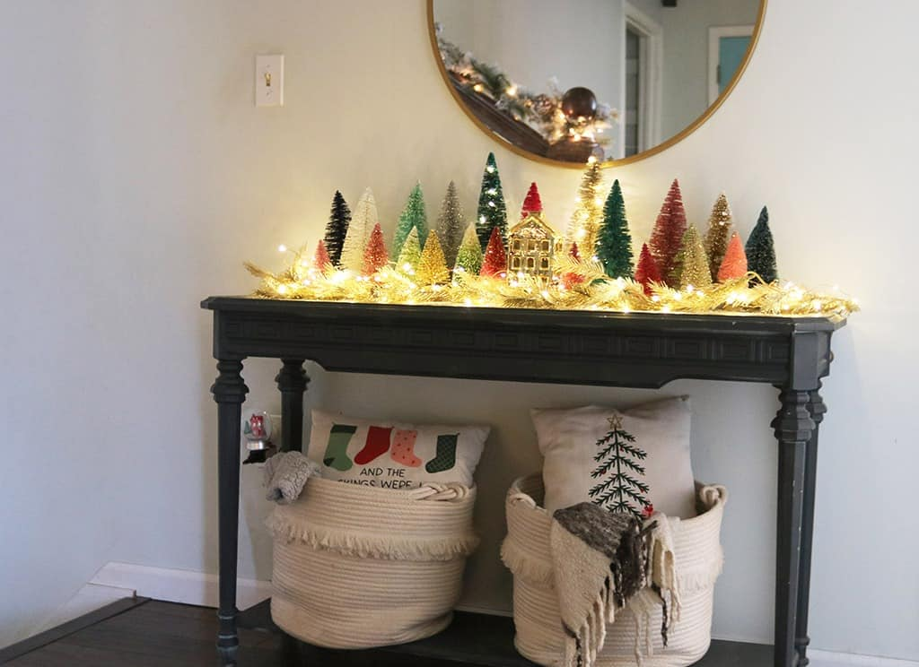 A modern and colorful holiday home tour full of affordable festivity and touches of fun throughout! Entryway