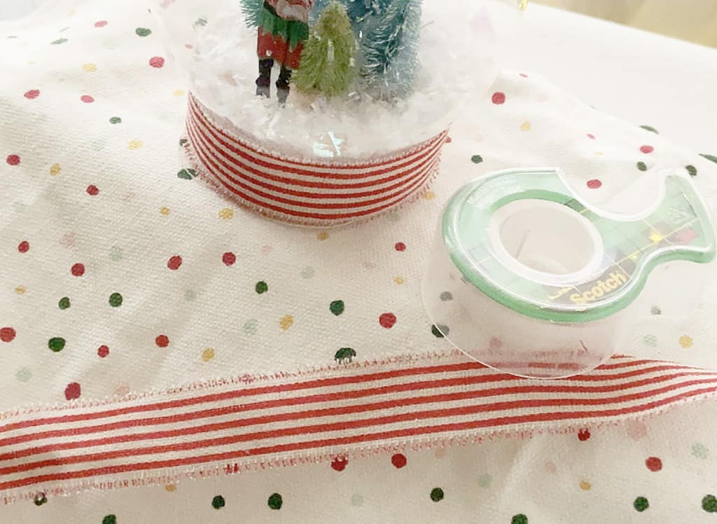 Add ribbon to snow globe base