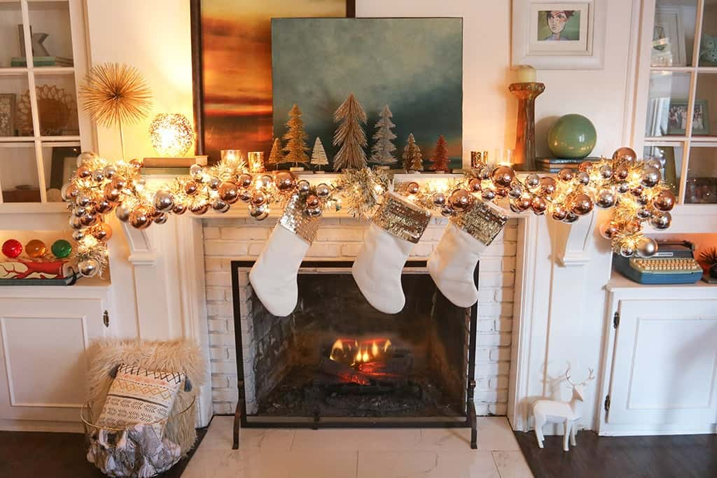 A modern and colorful holiday home tour full of affordable festivity and touches of fun throughout! A festive fireplace
