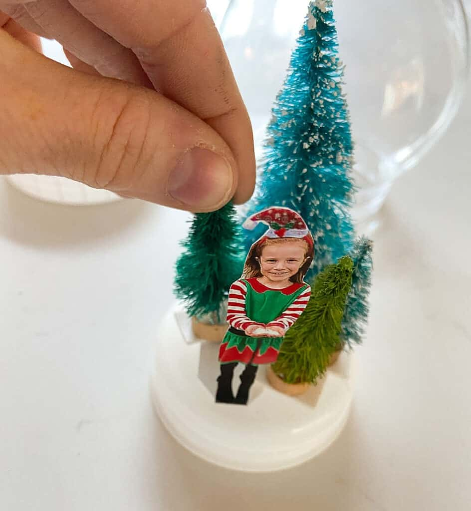 Tape your bottle brush trees and photo to base