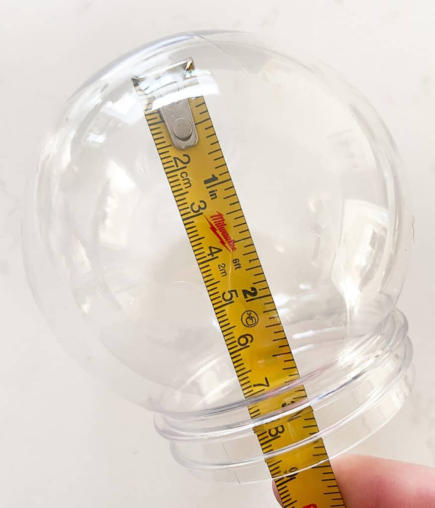Measure how tall photo should be inside snow globe