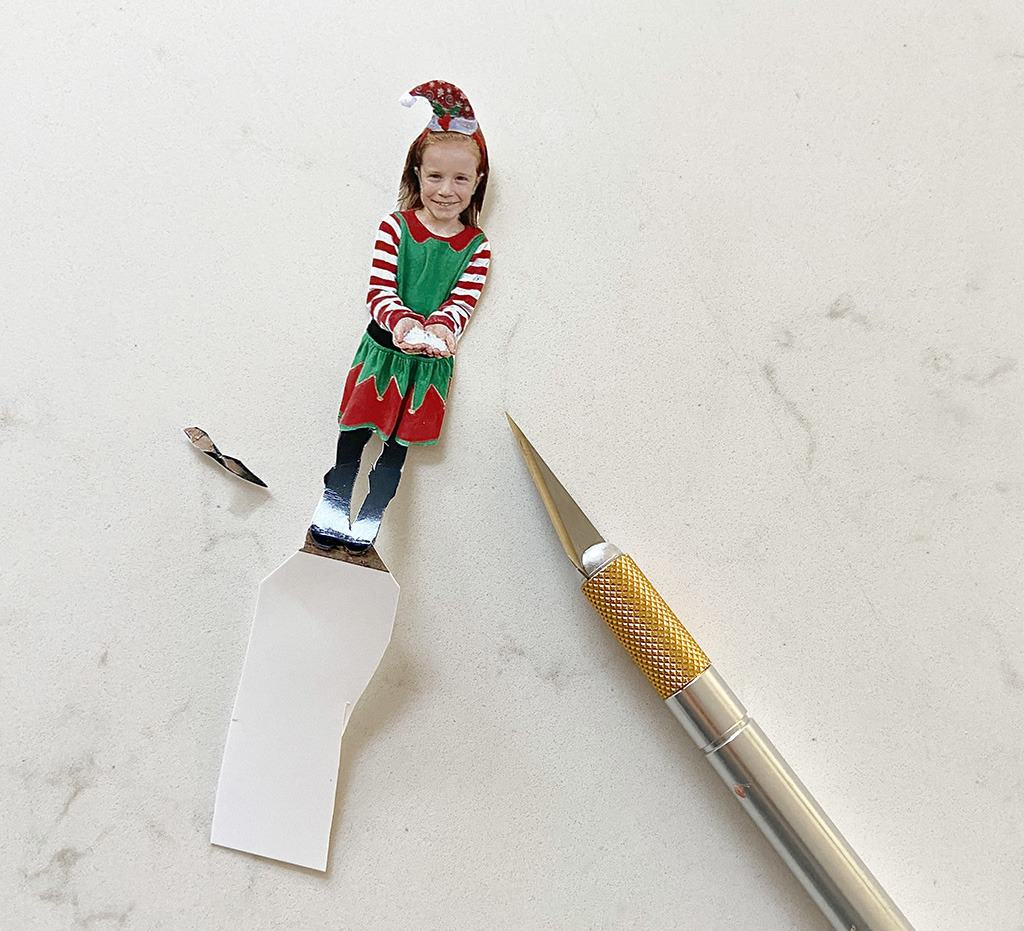cut out photo with exact-o knife and scissors