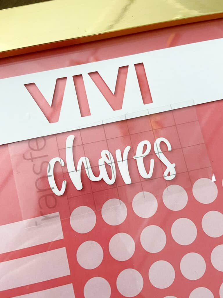 Use Cricut vinyl to personalized your DIY upcycled chore chart