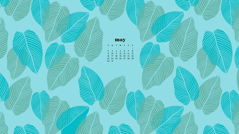 modern green and turquoise palm leaves on a aqua background