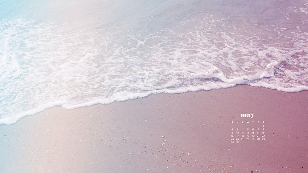 sand and beach wave at the ocean in pretty cotton candy colors