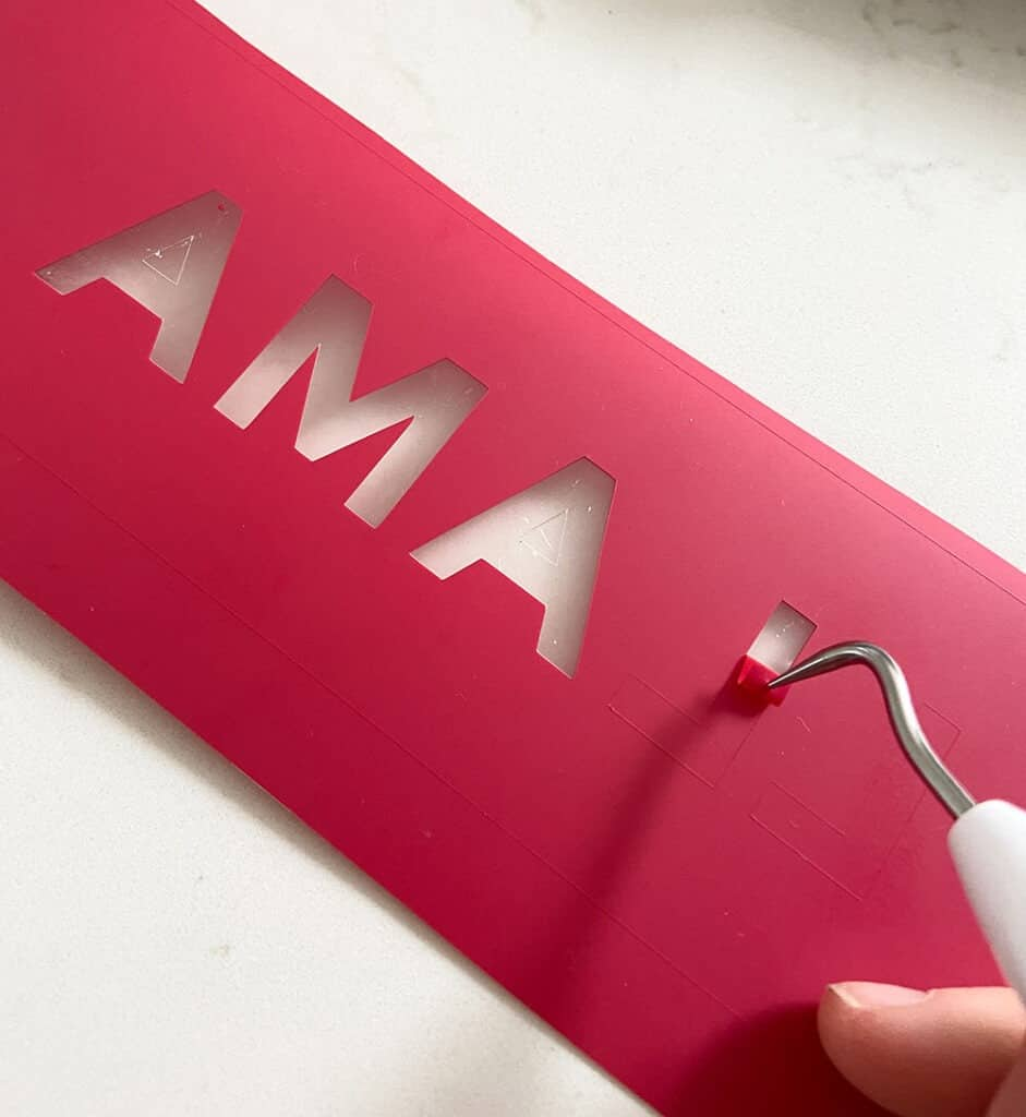 Weeding a LLAMA iron on design in red