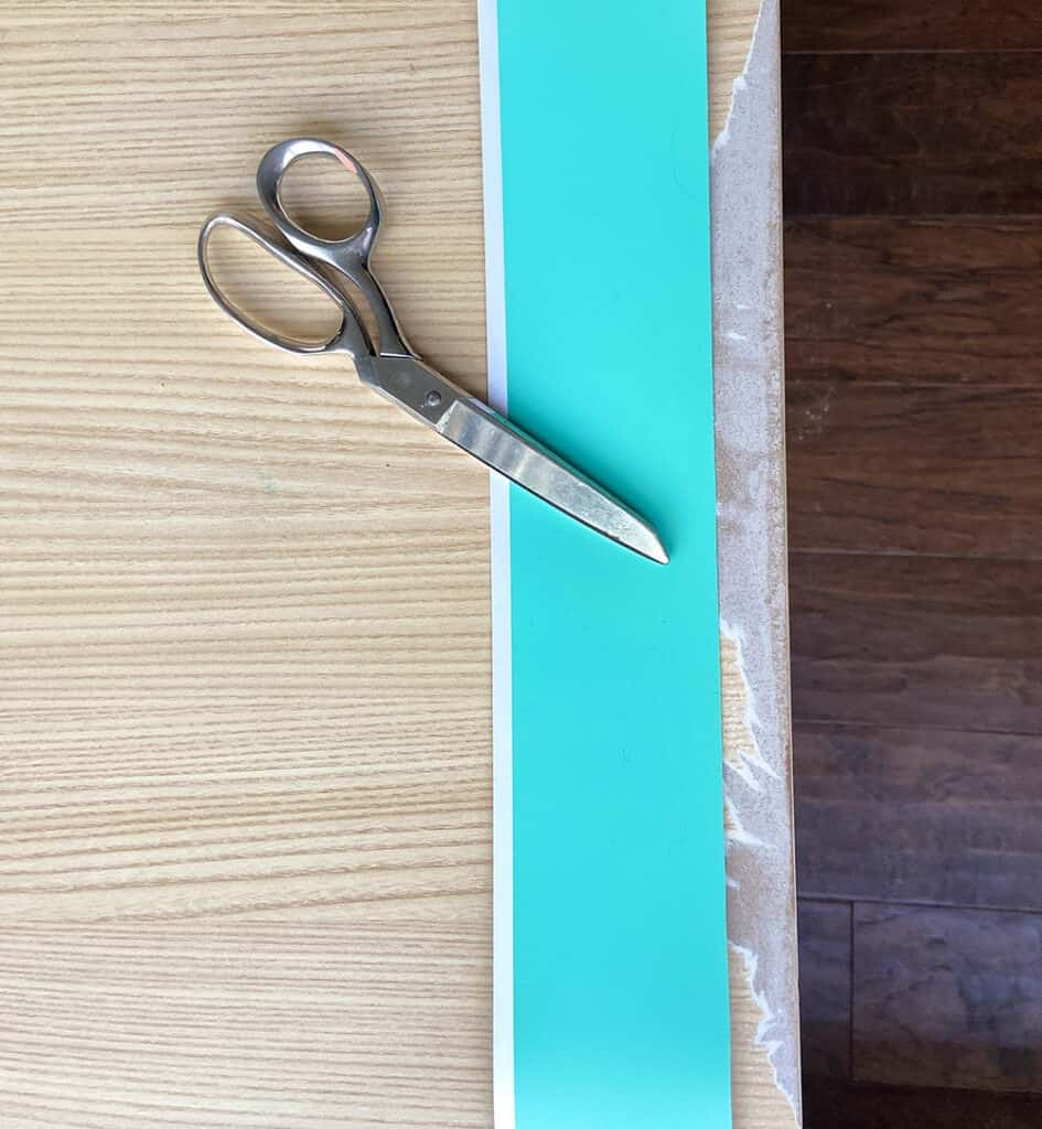 Cutting turquoise mint vinyl with scissors