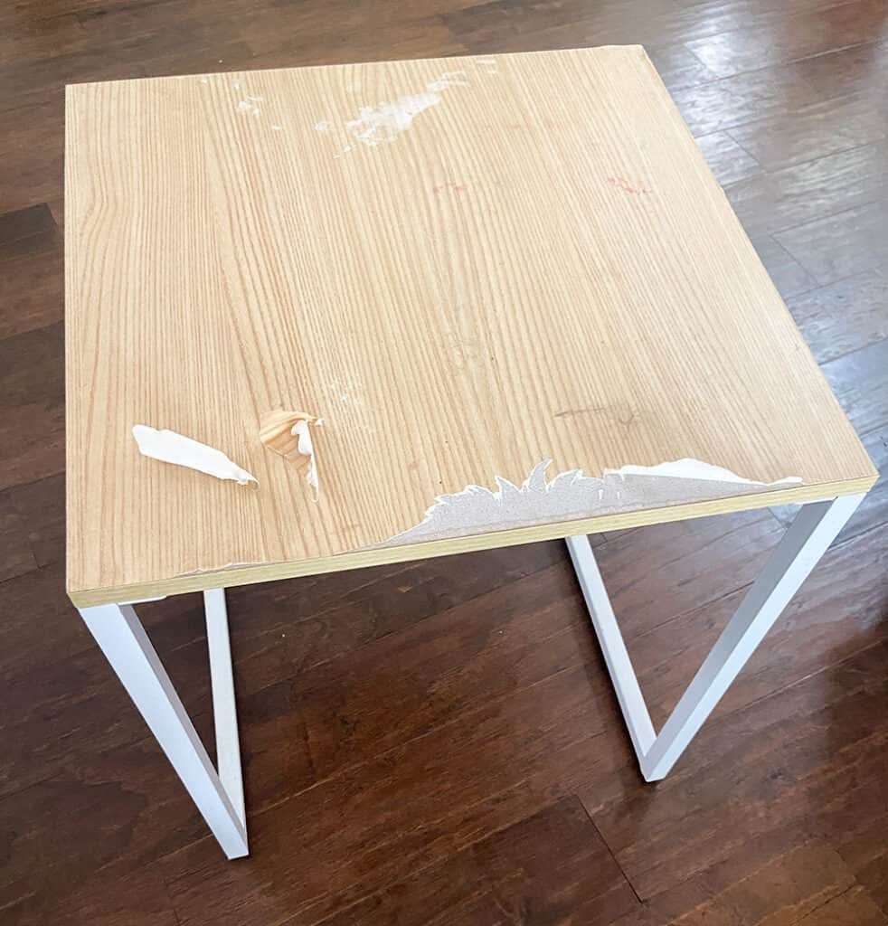 worn out and  damaged table top before