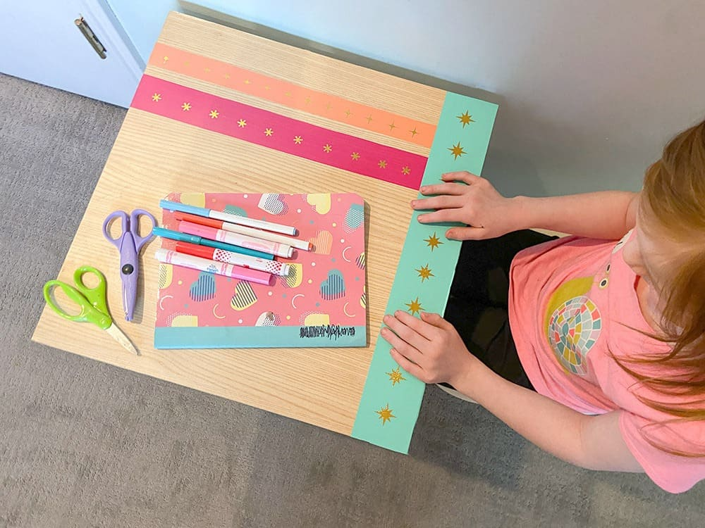 Using my Cricut Joy and some colorful vinyl, a fun and colorful table top design gave new life to our play room desk in just 10 minutes!