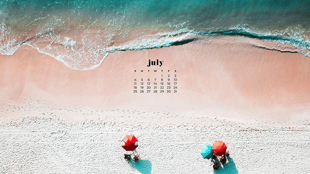 July 2021 wallpaper calendar aerial shot of beach and umbrellas