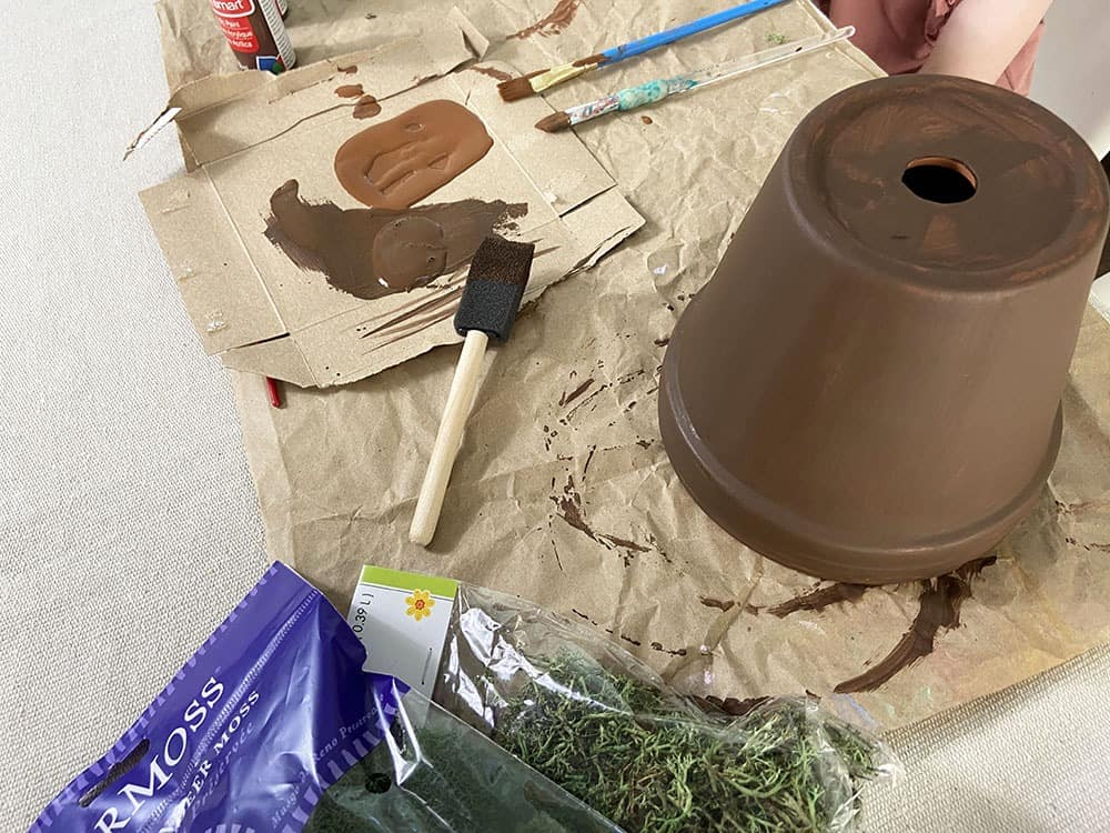 painting terra cotta pots brown to mimic tree look for gnome garden