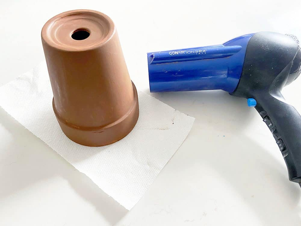 painting terra cotta pots brown to mimic tree look for gnome garden - dry with a har dryer