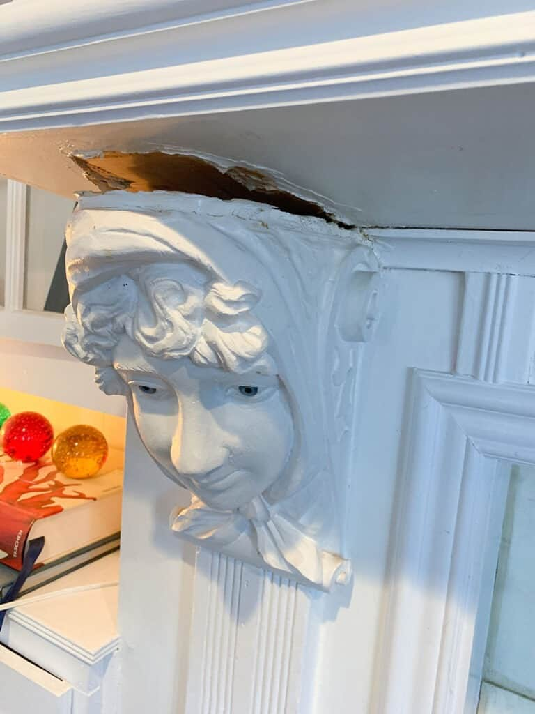 removing creepy corbels from a fireplace A step-by-step DIY fireplace makeover tutorial – See how it went from extra creepy to clean and classic on a very small budget!
