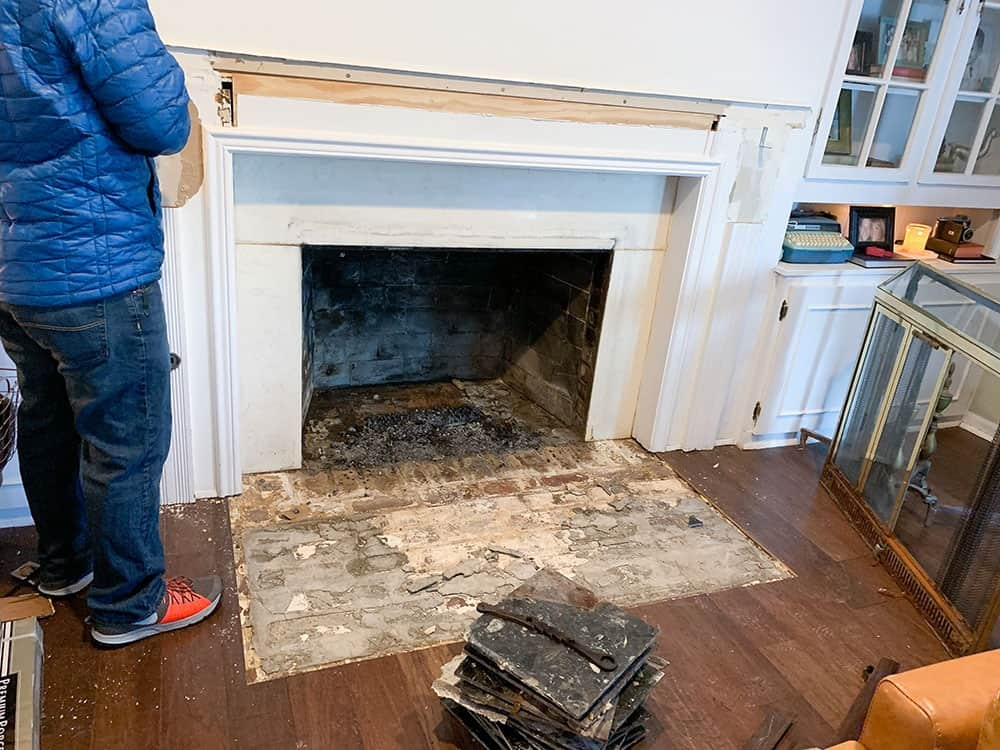 demo of old fireplace surround and corbels - fireplace makeover