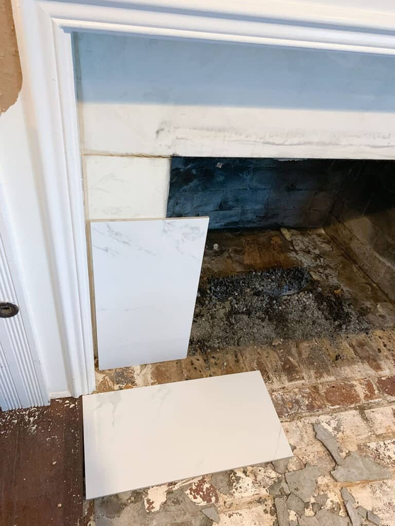 removing old fireplace tile - fireplace makeover