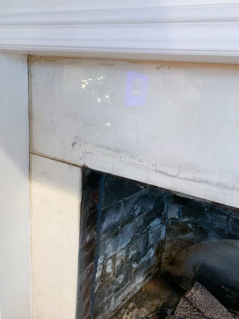 old fireplace tile - discovered brick behind it - fireplace makeover