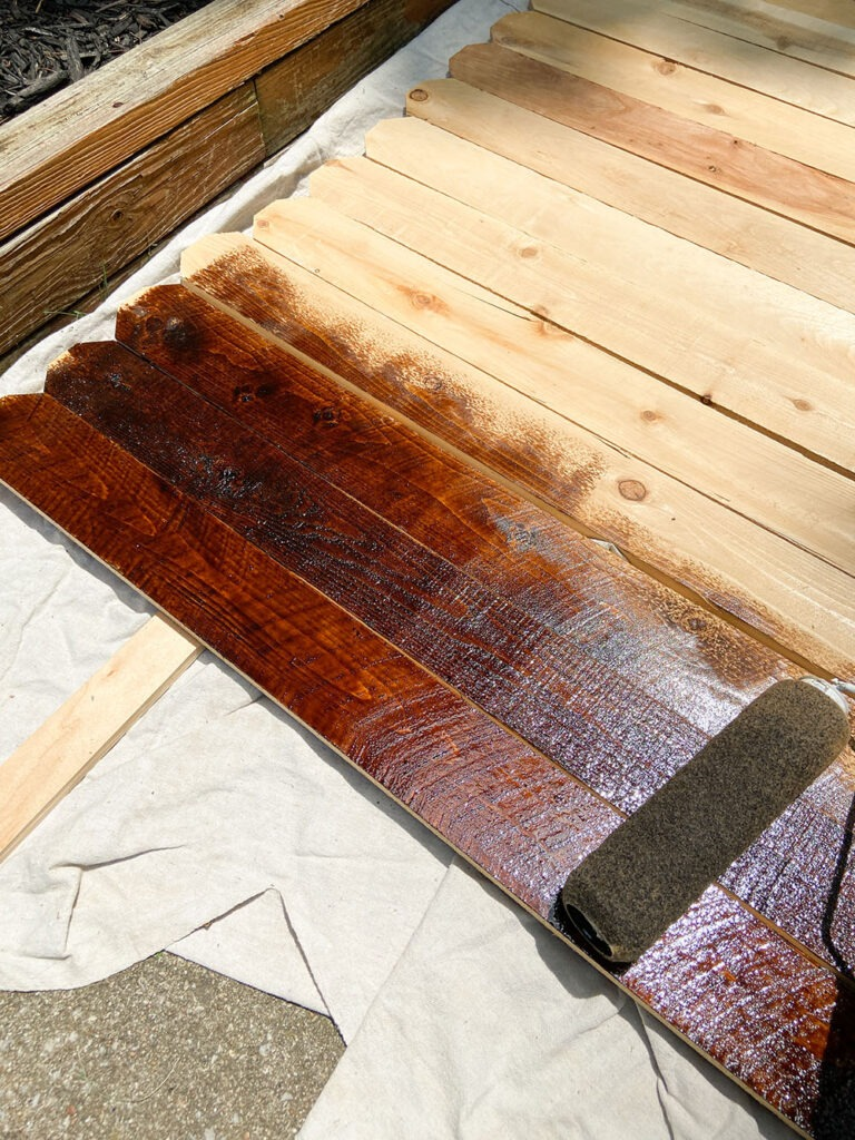 Staining wood fence picket boards with paint roller