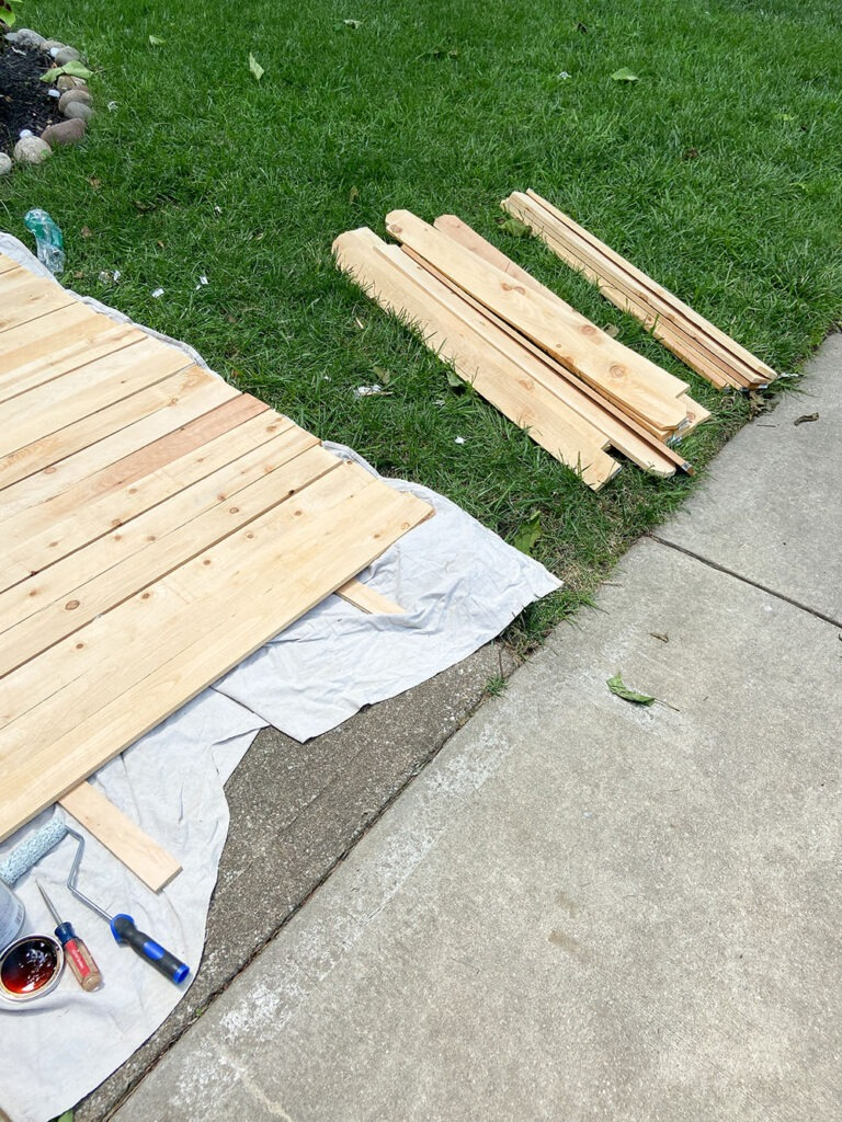 Staining wood fence picket boards