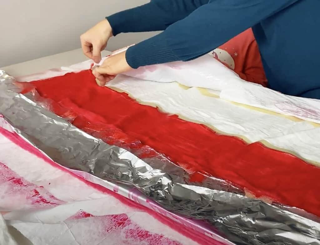 spray red tumble dye on muslin blanket