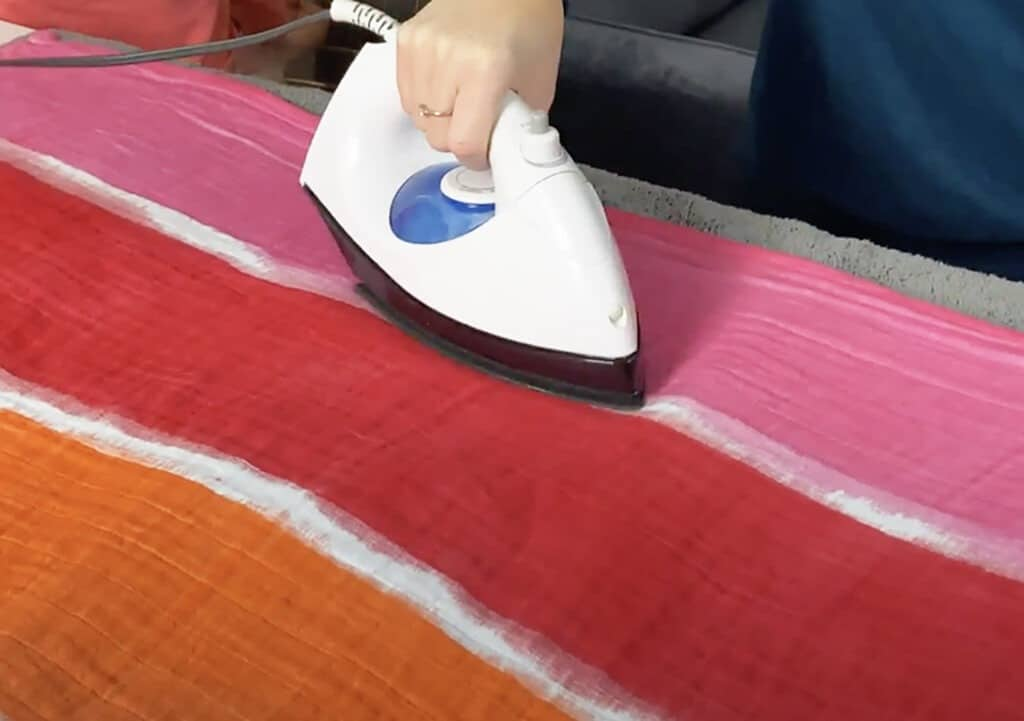 ironing the blanket to seal the dye