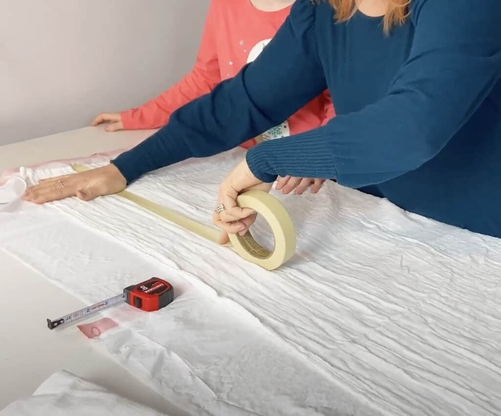 measure and tape off sections of blanket with masking tape