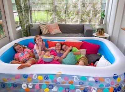 DIY inflatable kiddie pool movie watching lounge