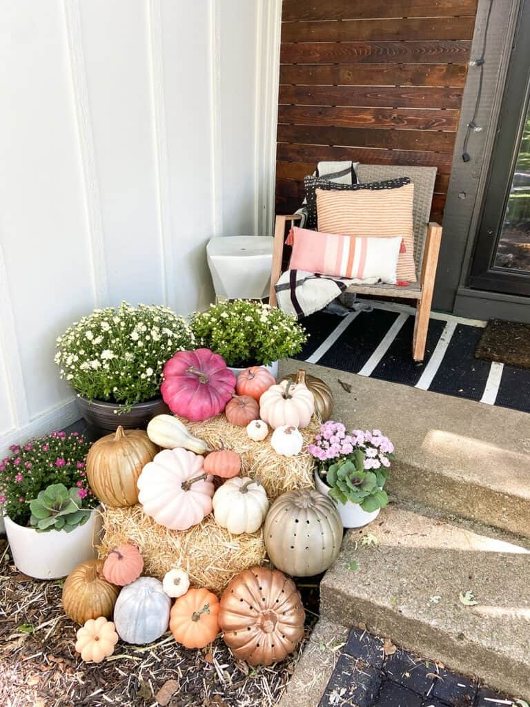 Fall front porch and window box decor tips with lots of colorful pumpkins and plants