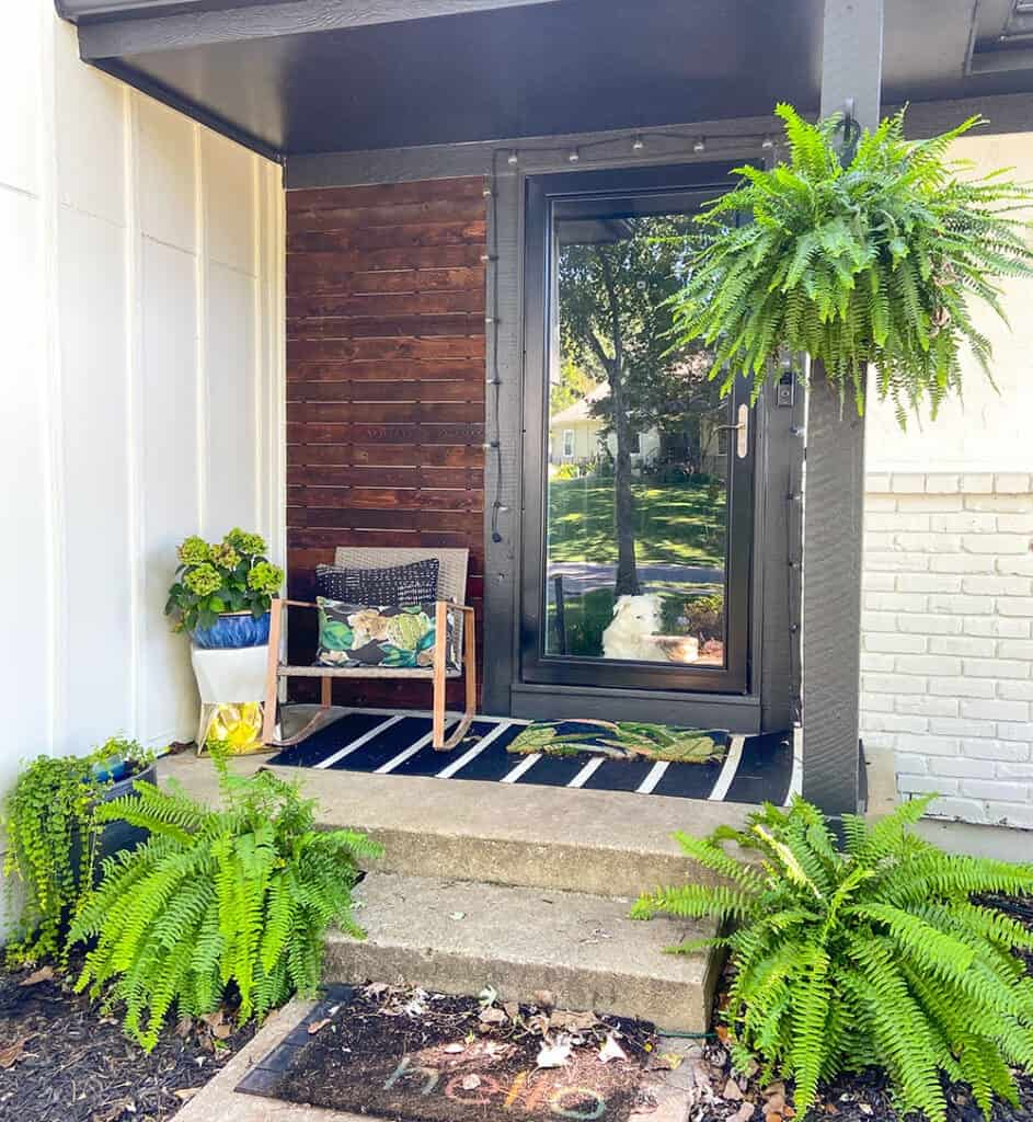 summer front porch with palm leaves and black and white stripes