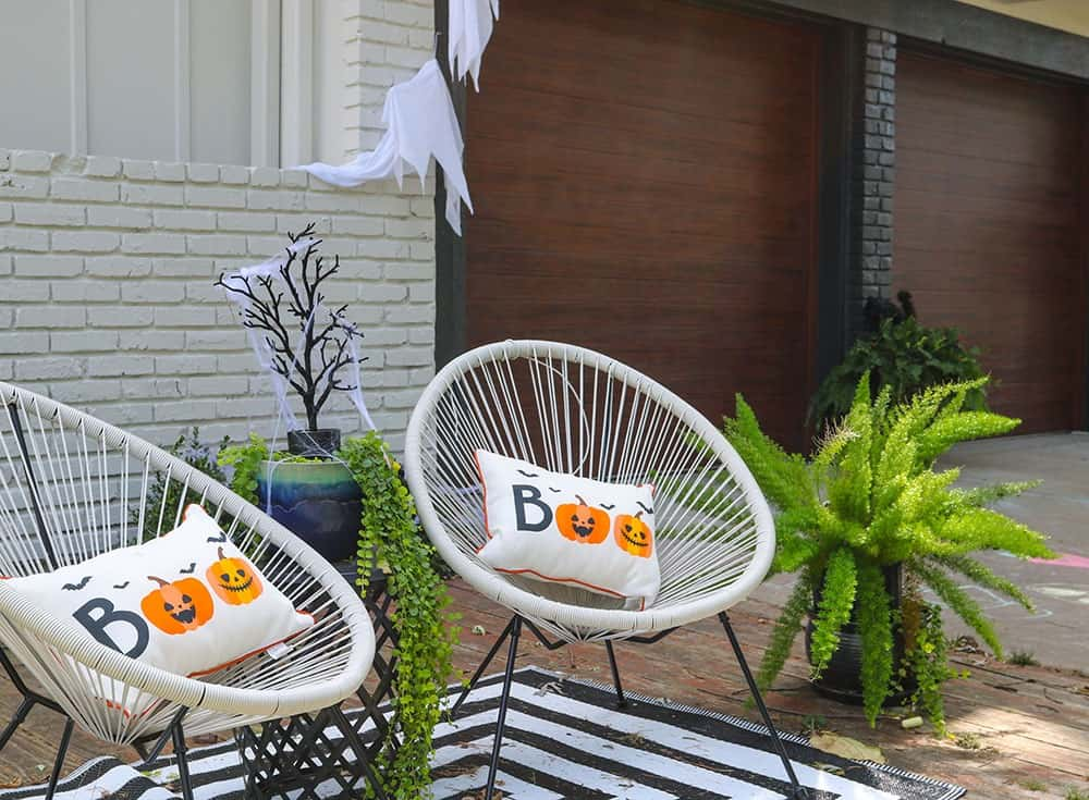 Boo halloween outdoor pillows and modern chairs
