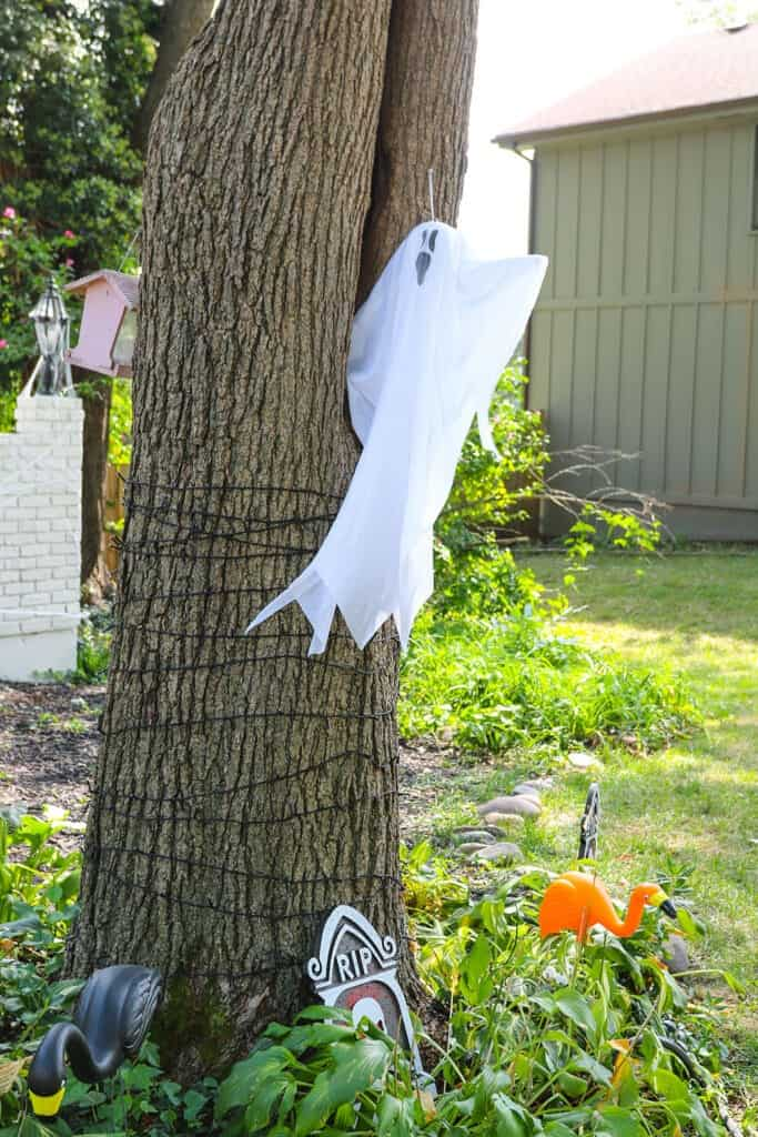 ghosts hanging in tree
