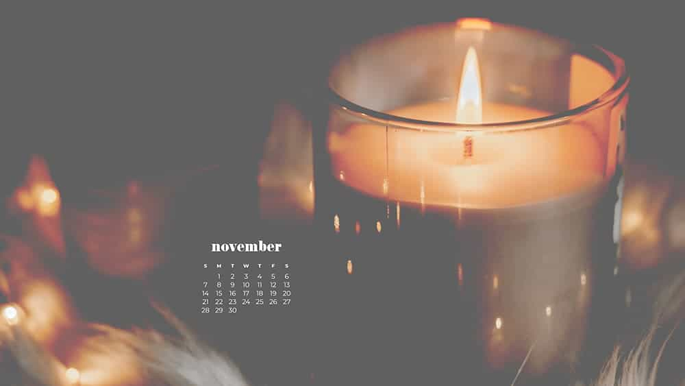 Cozy scene with a blanket, plant, and candle, soft overlay on top November - FREE wallpaper calendars in Sunday & Monday starts + no-calendar designs. 35 options for both desktop and smart phones!